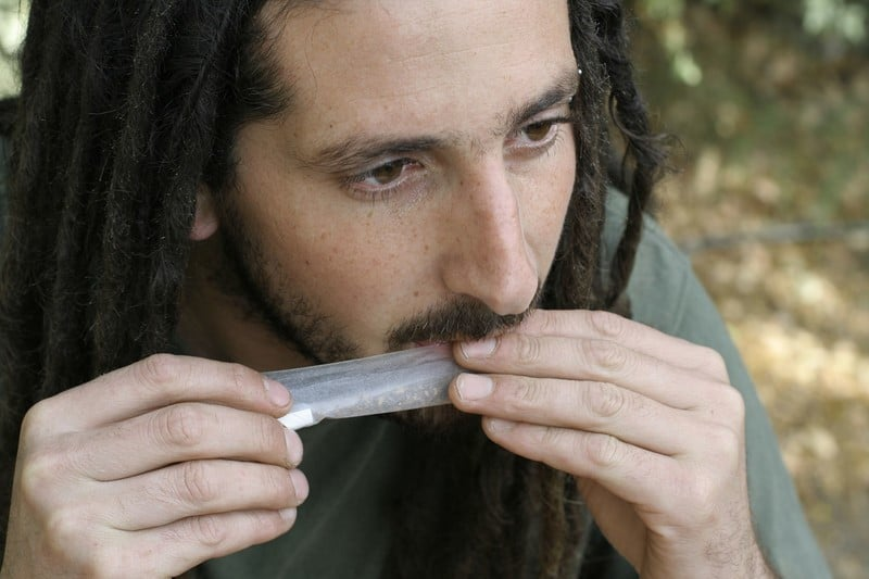 Man Rolling A Joint