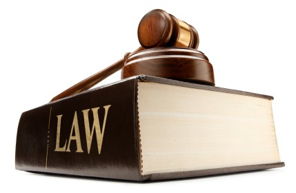 Police Warrants, Searches and Marijuana Laws. Law book and gavel.