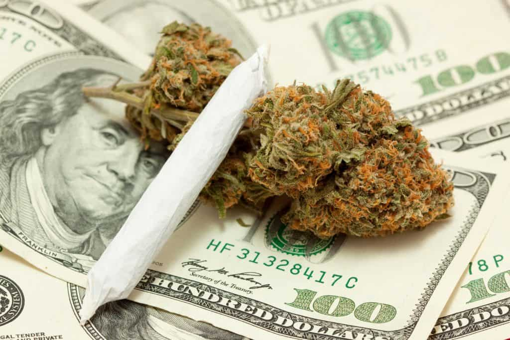 4 Proven Sales Promotions to Make More Money on 4/20. Cannabis on a stack of money.