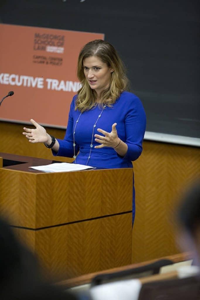 Marijuana Training In Colorado. Lady at a podium speaking.