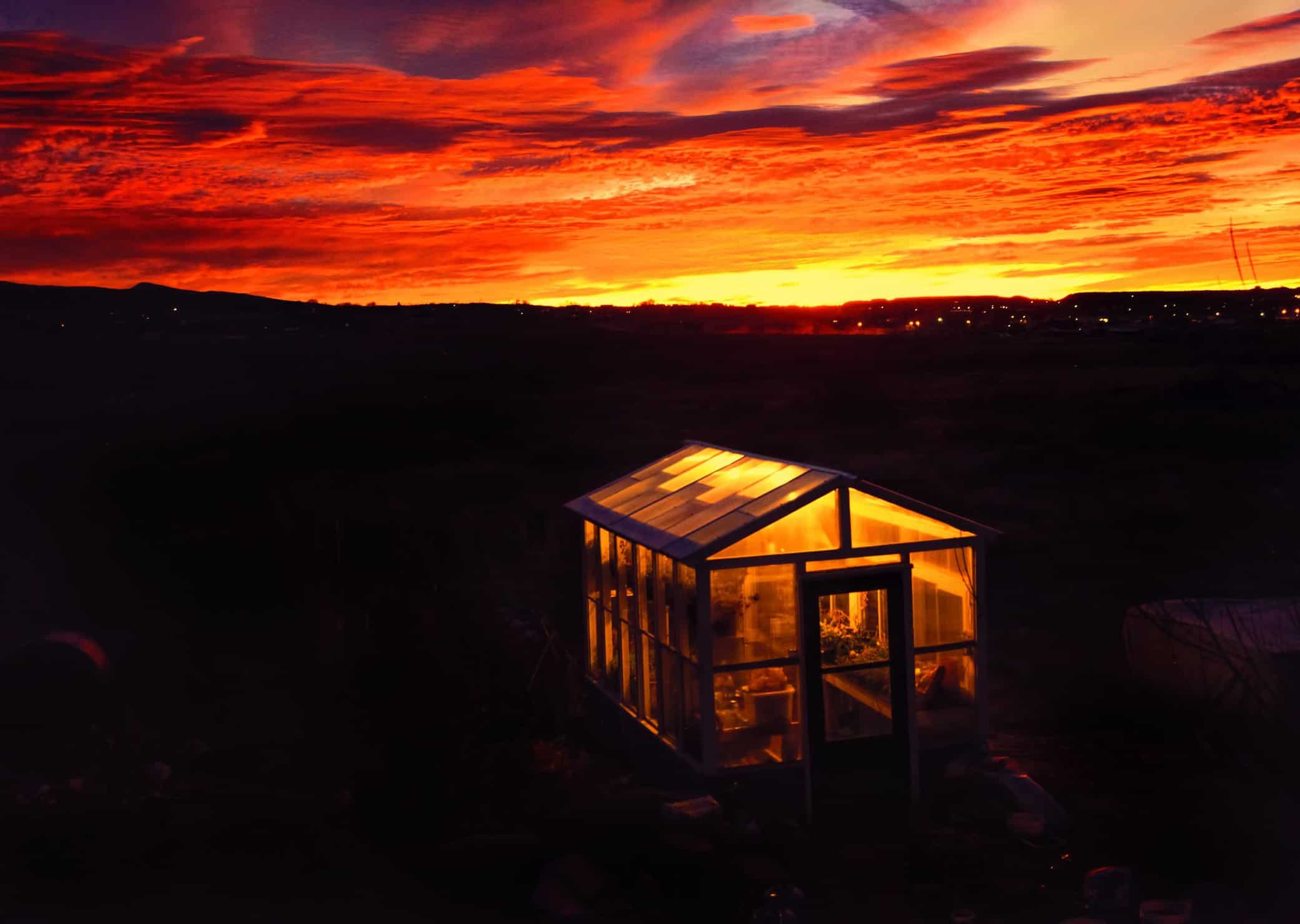 Ideal marijuana lighting for your winter grow. Cabin with colorful sky.