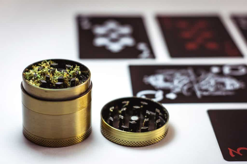 The Best Substitutes For A Marijuana Grinder. Gold grinder with herbs in it.