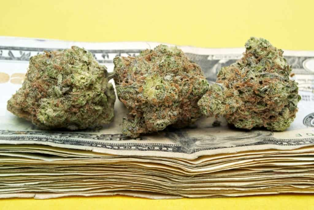 Learn More about the Best-Selling Marijuana Strains. Marijuana buds on top a stack of money.