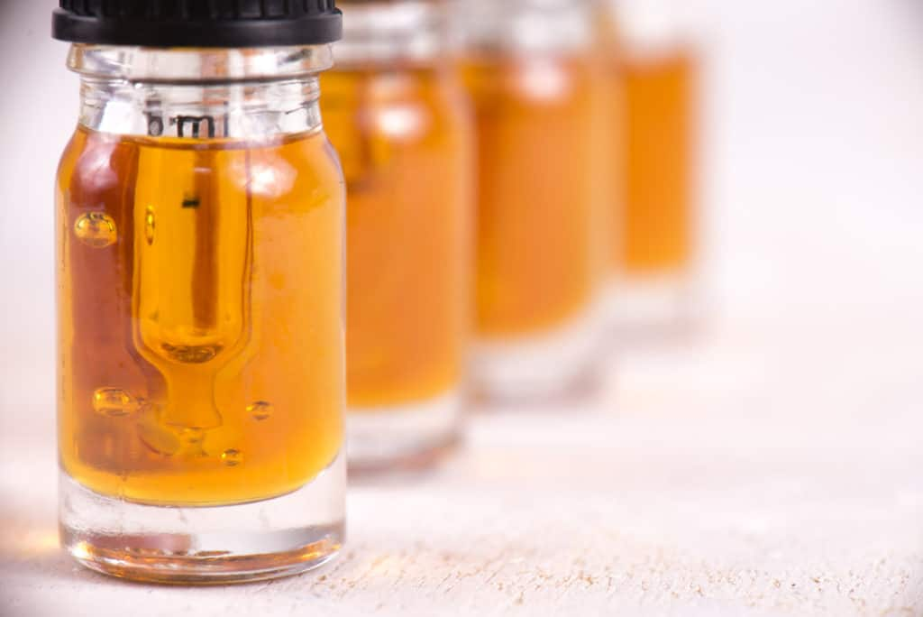 CBD oil in glass jars. CBD for arthritis