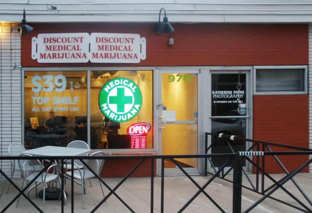 Curaleaf Gilbert Cannabis Dispensary: Menu, Deals & Reviews. Storefront with gate.