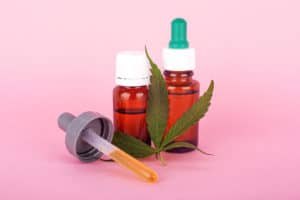 How To Become A Budtender In A Cannabis Dispensary. Tinctures and a marijuana leaf.