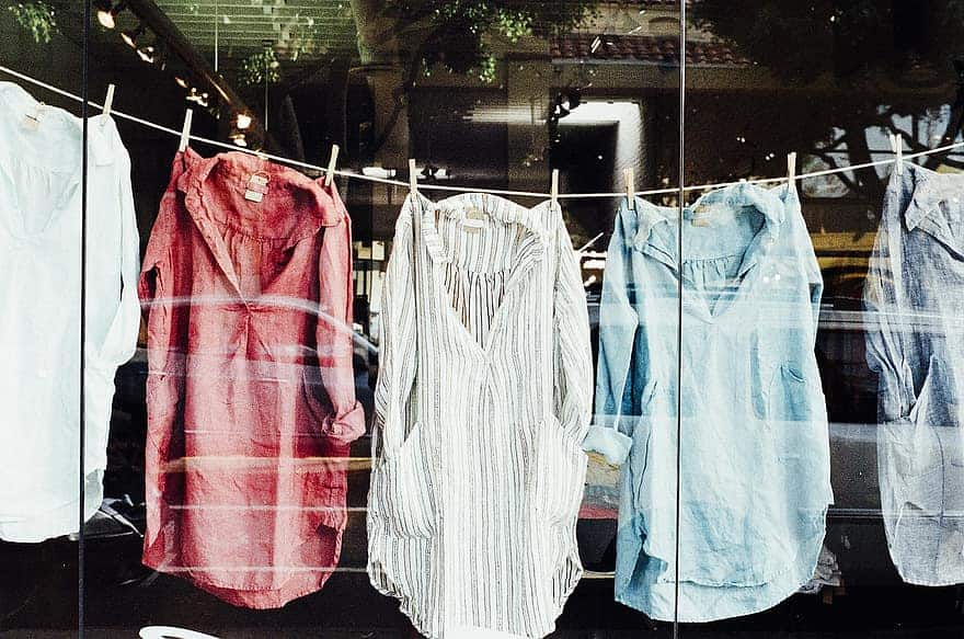 The ultimate guide to hemp clothing. Shirts hanging on clothes line.