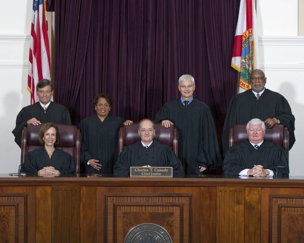Make it Legal Florida Program. 7 judges in green capes.