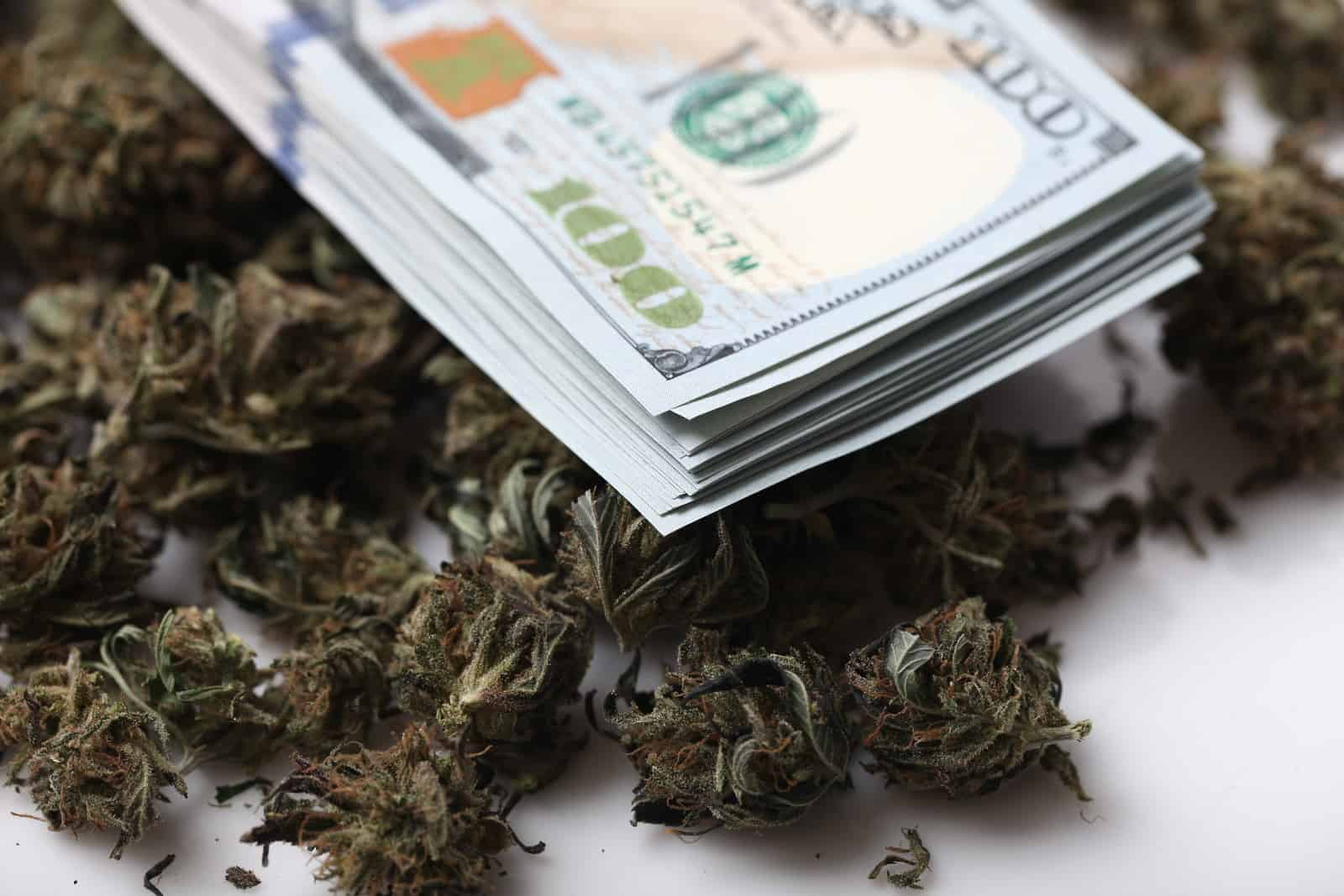 Safe Banking Act Included In U.S. House's Coronavirus Relief Bill. Stack of money on weed buds.