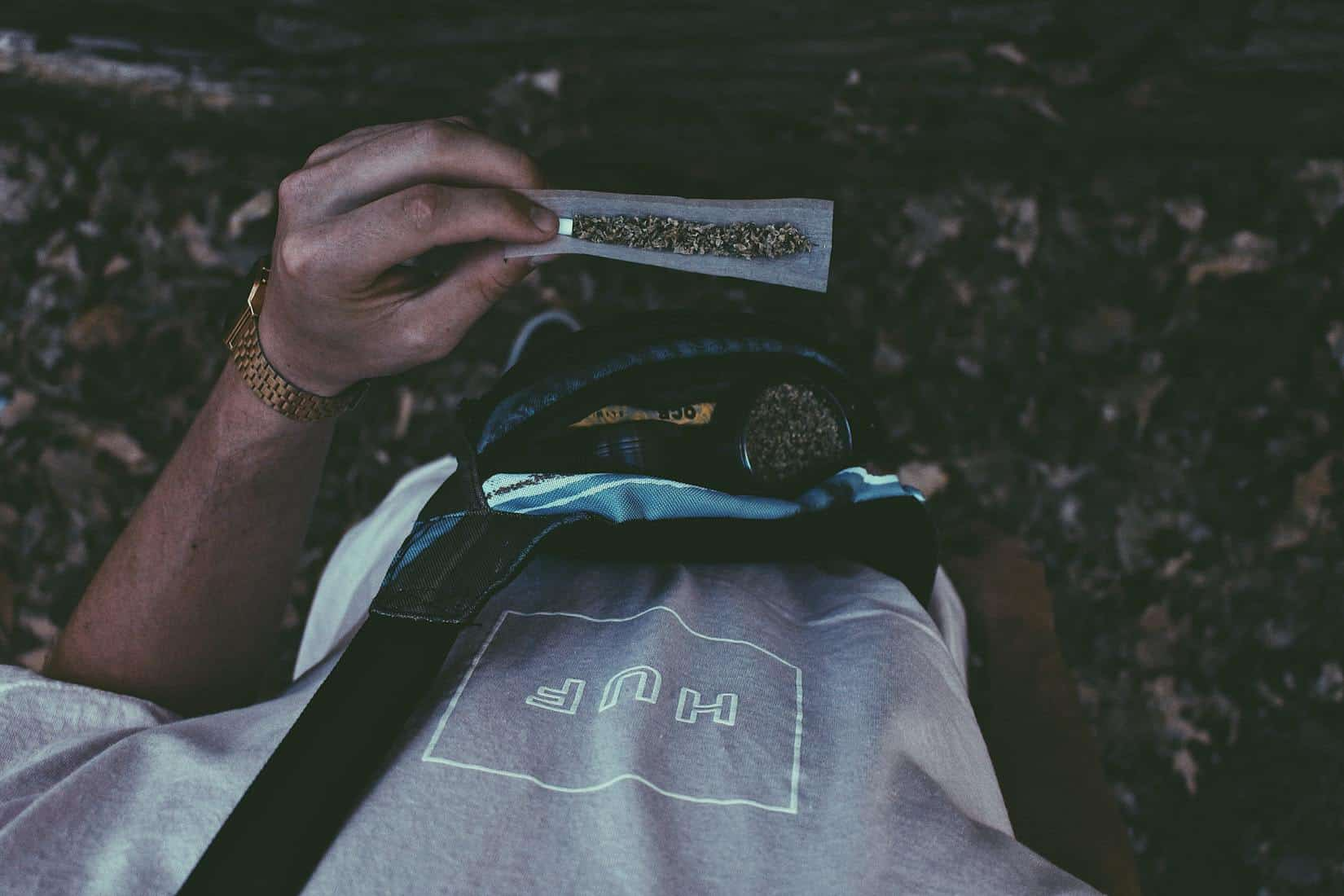 The Best Smell-Proof Bags For Your Marijuana. Man holding a blunt.