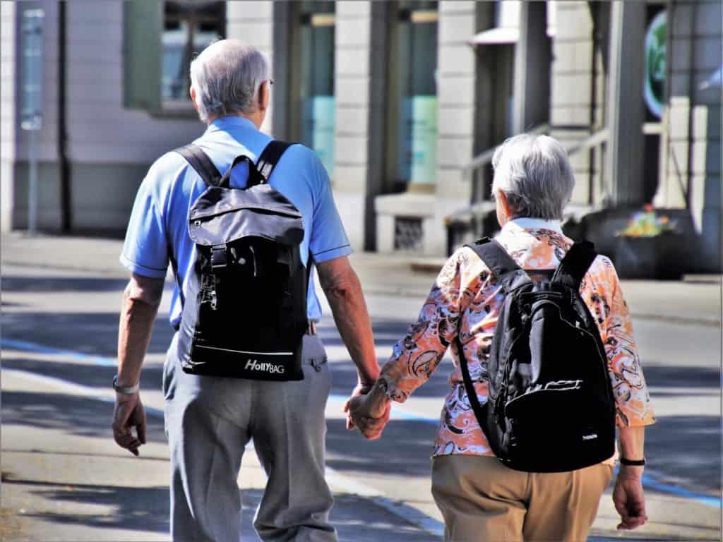 7 Benefits of Cannabis for Seniors. 2 seniors walking.