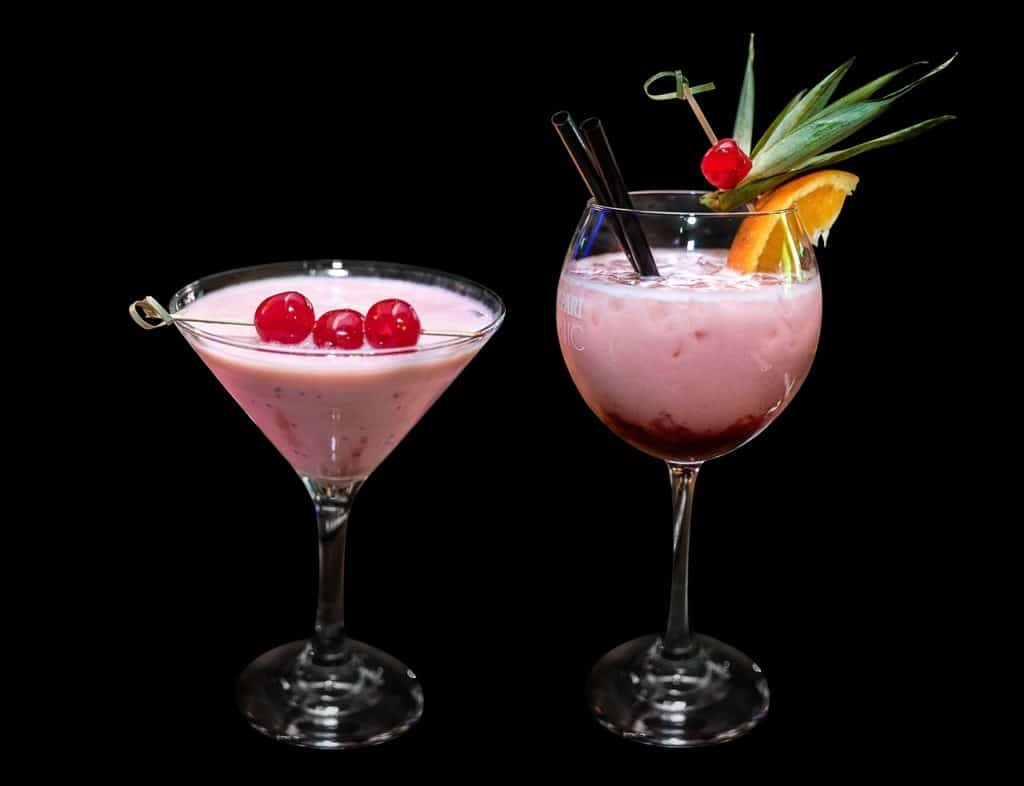 A Guide to Cannabis Cocktails. Two drinks in black background.