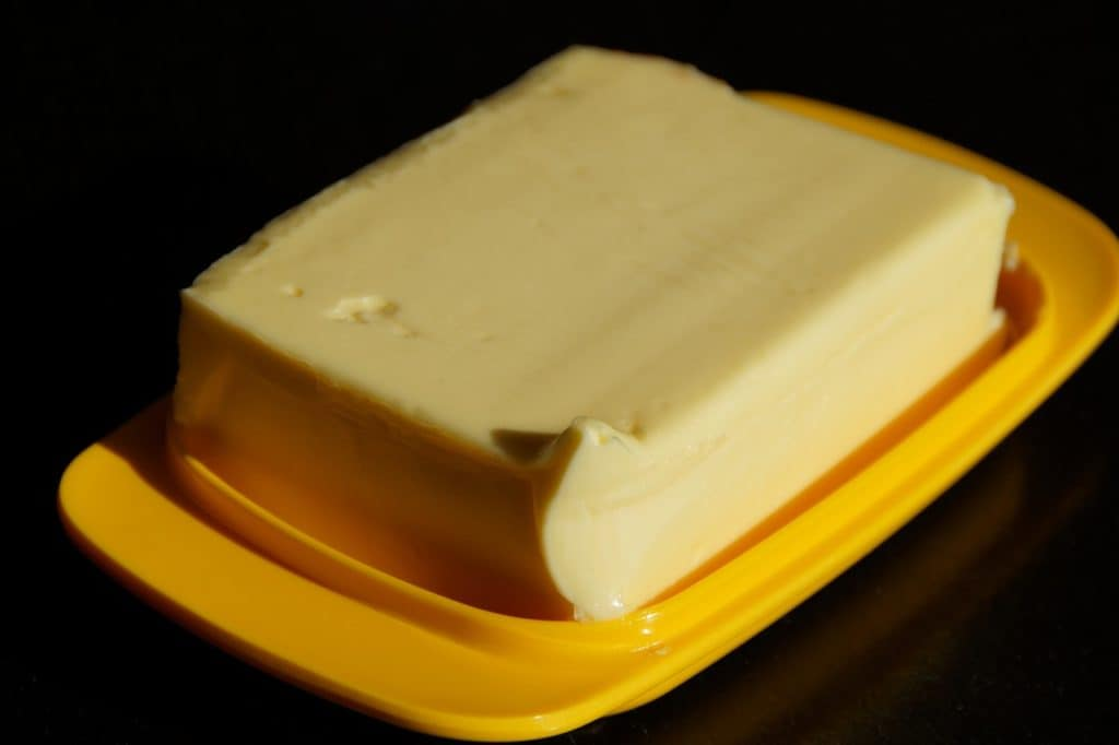 Vegan CBD Butter on yellow container