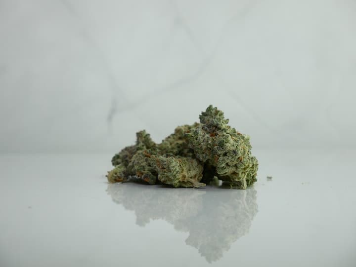 Sativa Strains on a white marble surface.