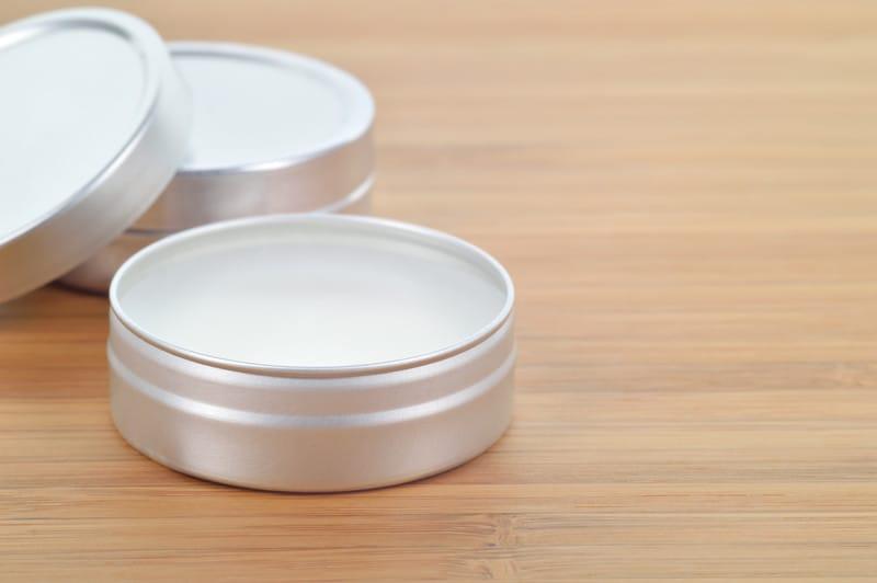 Marijuana lip balm in silver containers