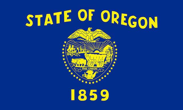 Oregon State flag in blue with yellow lettering.