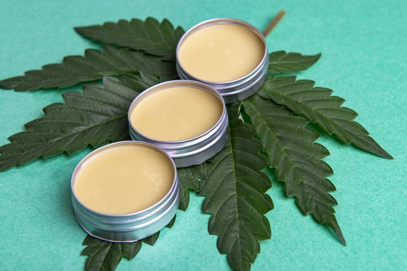 Cannabis salve recipe on a cannabis leaf.