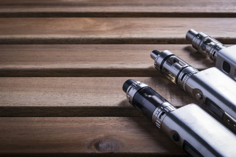 Best e-liquid brands on wooden panelling.