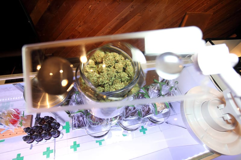 Cannabis dispensary job in Massachusetts. Weed on counter.