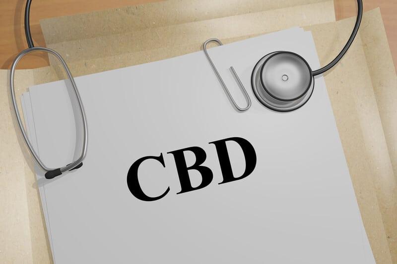 CBD Dosage Chart on a manilla folder with a stethoscope.