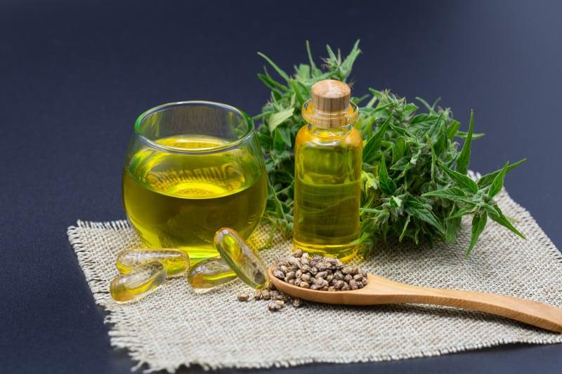 Hemp seed oil for hair and cannabis leaves.