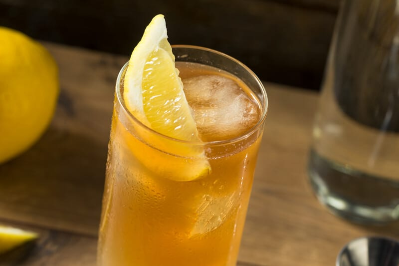 jeremiah weed peach sweet tea vodka in a glass with a lemon