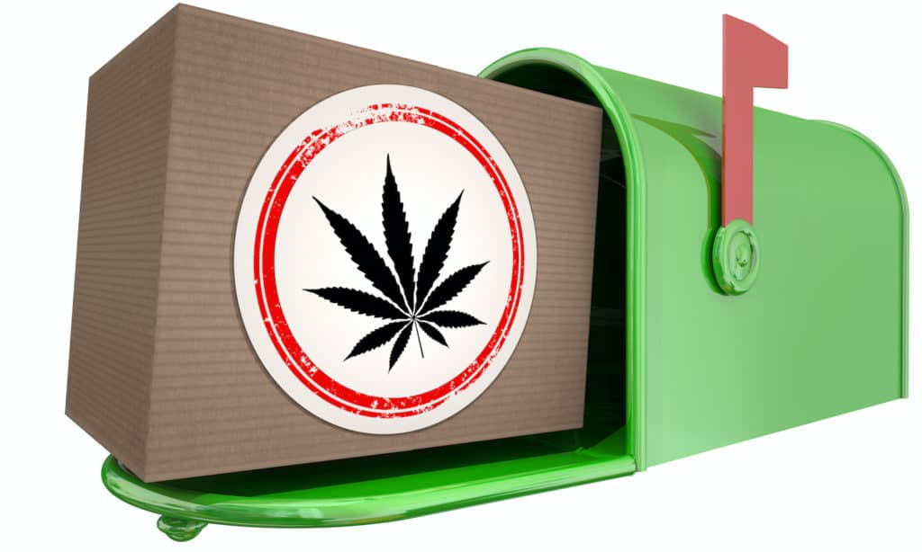 cardboard box with weed sticker in a mailbox, can you mail weed