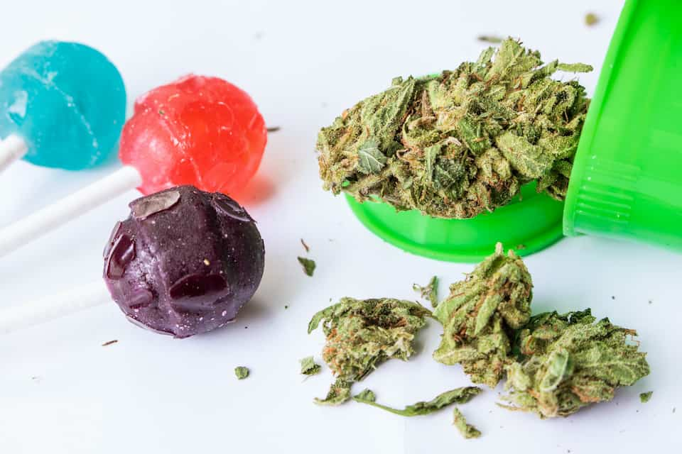 weed in green bowl next to colorful suckers, how to make THC candy