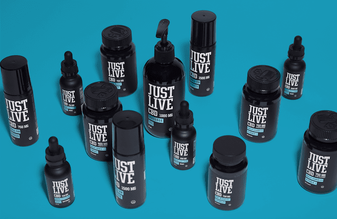 cbd tinctures and oil spread out on blue surface, just live cbd review