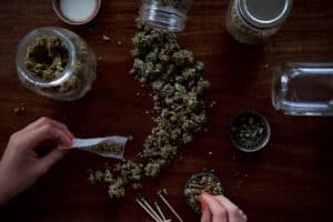 different kinds of marijuana on wood table, marijuana reviewer jobs