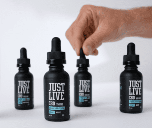 cbd oil tinctures with hand squeezing one