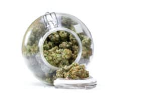 marijuana in a glass jar tipped over, death bubba strain