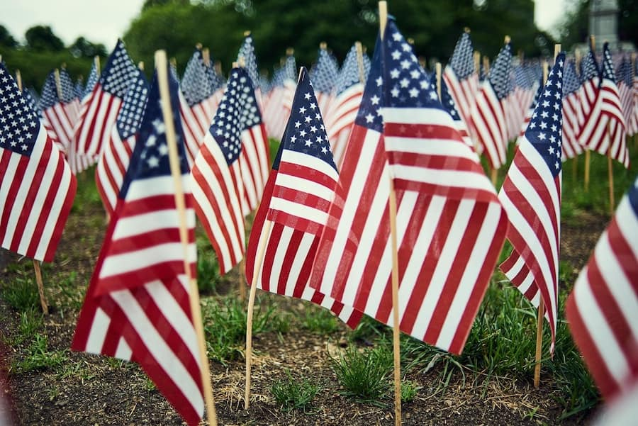 american flags in the ground honoring our fallen heroes