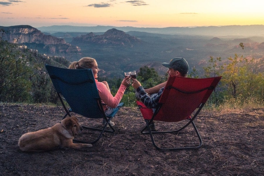 two people in chairs on top of mountain, camping spots for cannabis lovers
