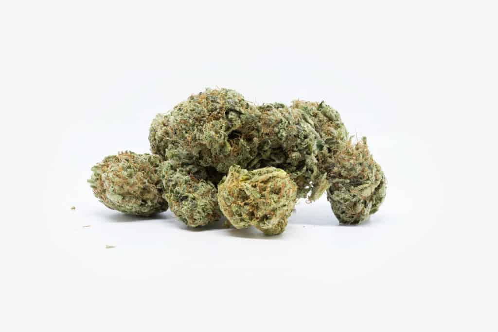 marijuana nuts on white surface, donkey butter strain