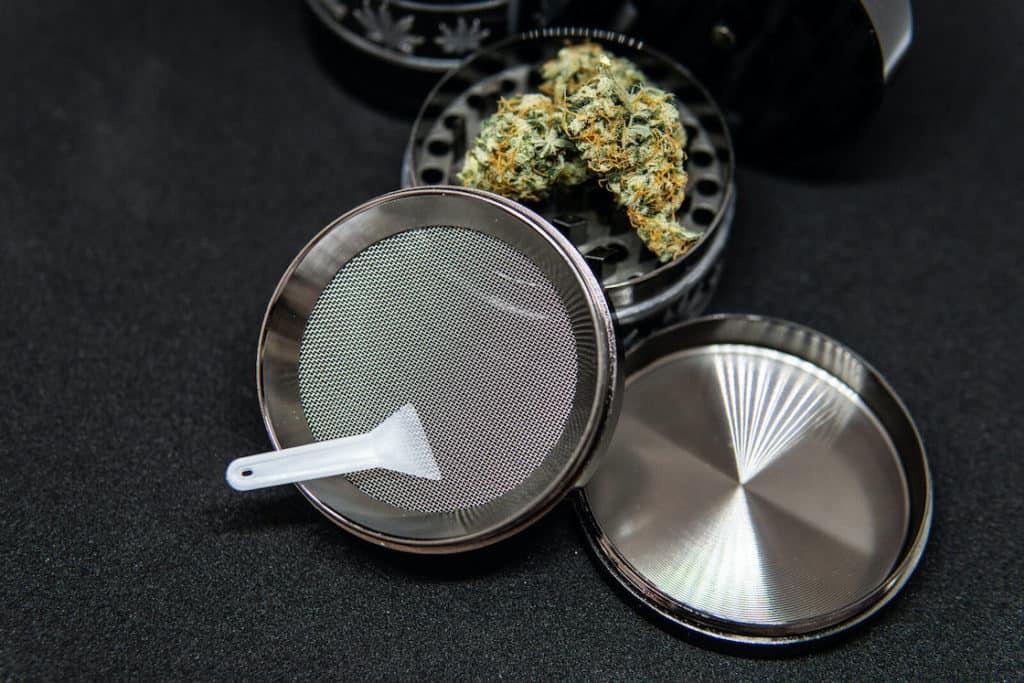 metal weed grinder with buds in it, how to clean a weed grinder