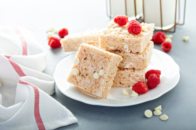 rice crispy treats on a plate with raspberries, cbd rice crispy treats
