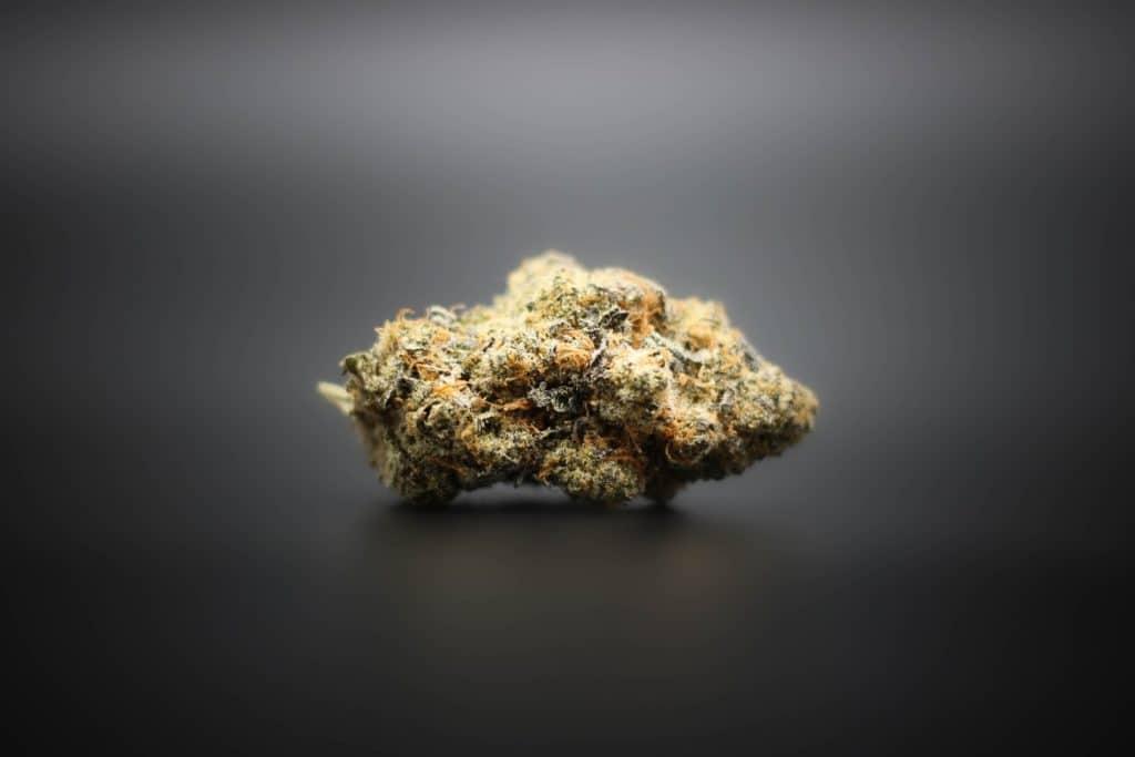 delta 9 strain of cannabis on black surface