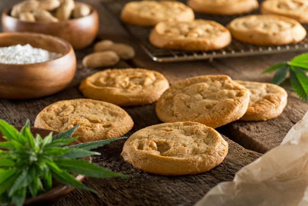 cookies on table with cannabis leaf, no bake edibles with cannabutter