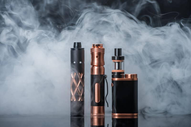 black and gold vapes against smoke, cannabis insurance